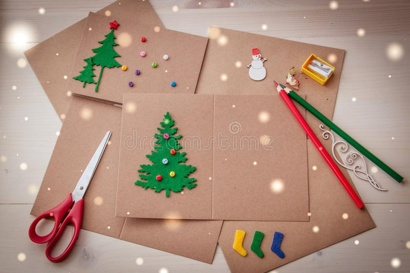 Signing Handmade Christmas cards. Felt, scissors, buttons, Christmas-tree, scrapping. Flat lay stock image