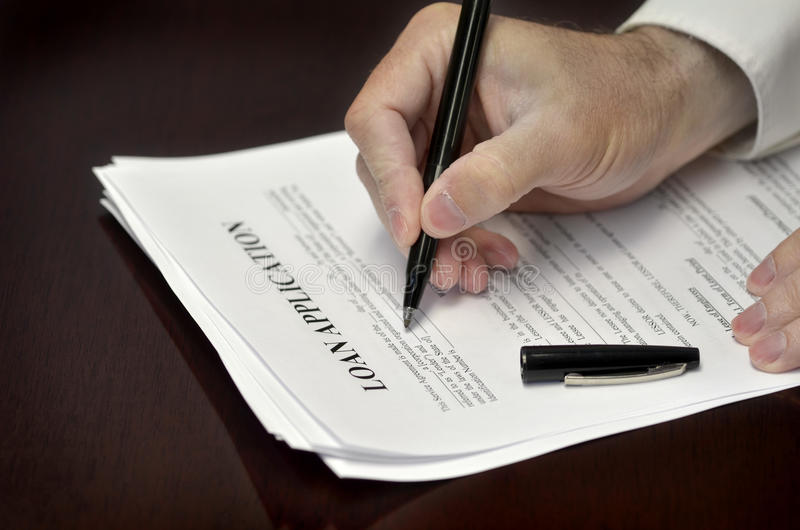 Signing Loan Application royalty free stock image