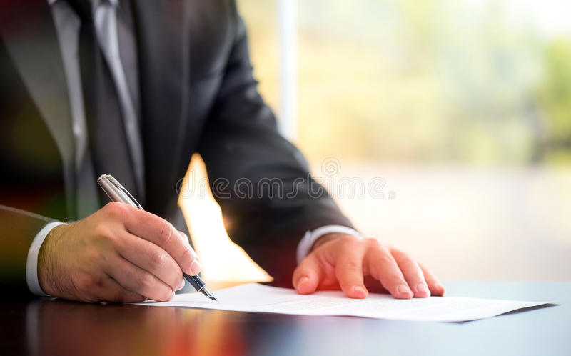 Signing Official Document. Businessman Signing An Official Document stock images