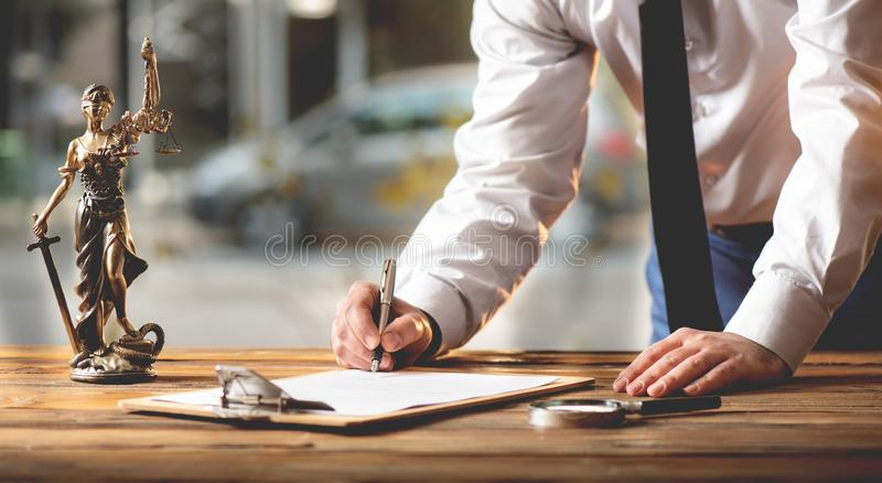 Signing Official Document and Justice Concept stock image