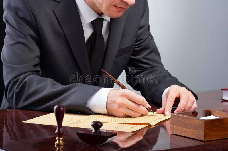 Signing testament royalty free stock photography