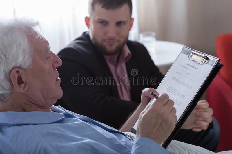 Signing the testament stock image