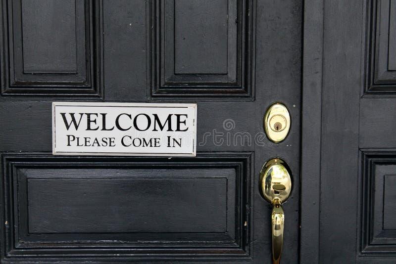 Signo positivo simple en puerta negra imágenes de archivo libres de regalías