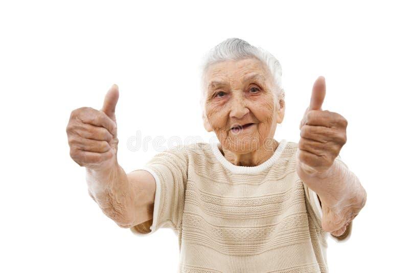 Signora anziana con i pollici su fotografie stock