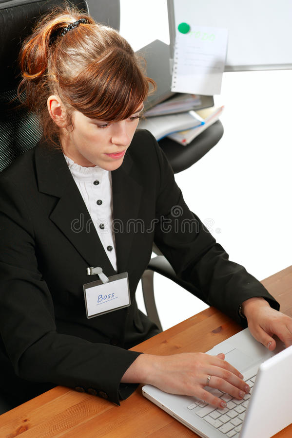 Signora di affari con un computer portatile fotografie stock