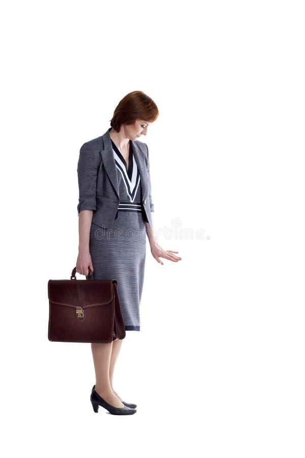 Signora di affari su un fondo bianco immagini stock