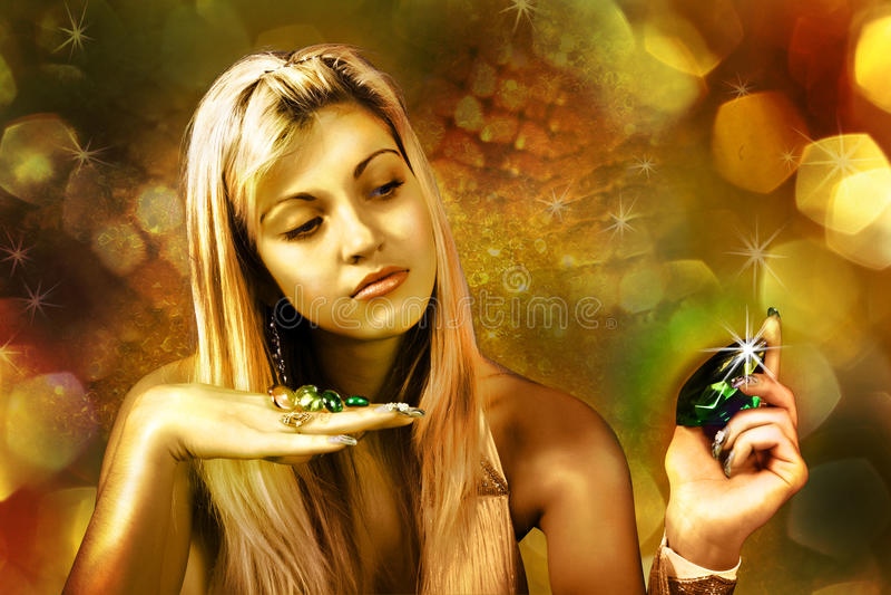 Signora dorata con i diamanti fotografia stock libera da diritti