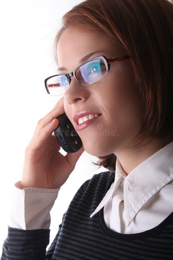 Signora femminile di affari sul telefono immagine stock