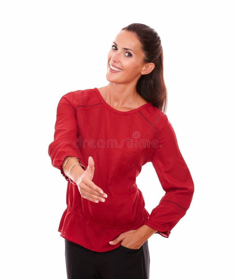 Signora ispanica affascinante con la mano di saluto immagini stock libere da diritti