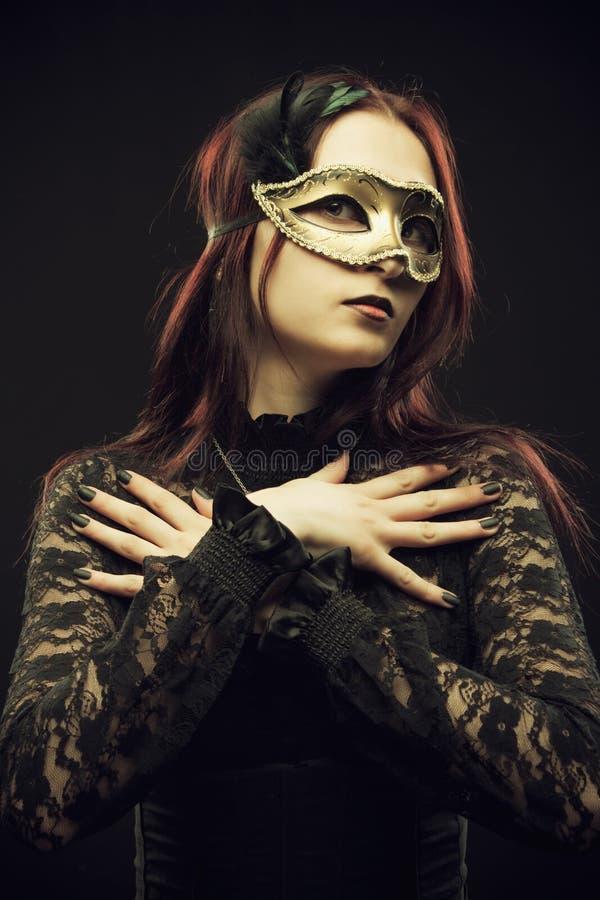 Signora nella maschera fotografie stock