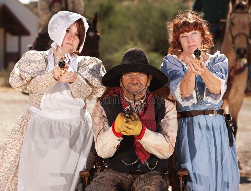 Signore e cowboy muniti in sedia a rotelle fotografia stock libera da diritti