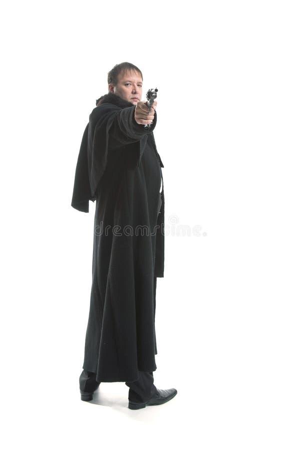 Signori che tengono pistola fotografia stock