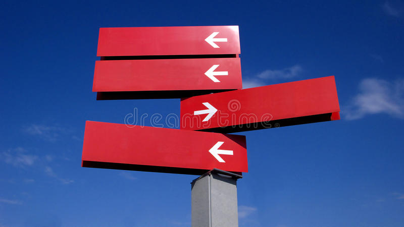 Signpost. Concept image of a signpost against a blue sky royalty free stock image