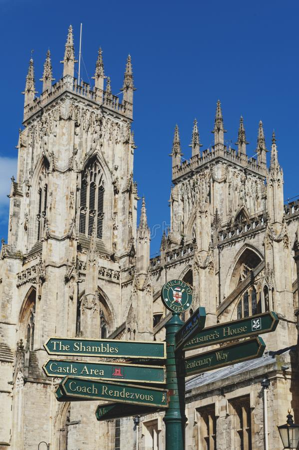 Signpost in front of York Minster, gothic cathedral and major tourist landmark of the City of York in England, UK royalty free stock photo