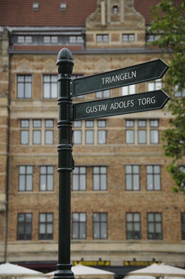 Signpost in Malmo, Sweden. Iron signpost in Malmo, Sweden, giving directions for two of the landmarks of the town: Triangeln and Gustav Adolfs Torg stock photography