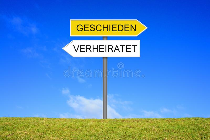 Signpost showing Married and Divorced german. Signpost outside is showing Married and Divorced in german language stock photo