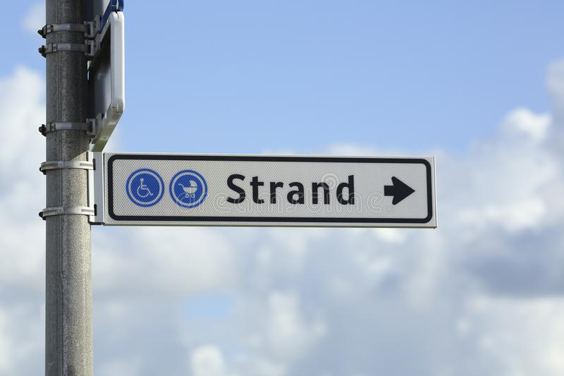 Signpost showing the way to the beach stock photo