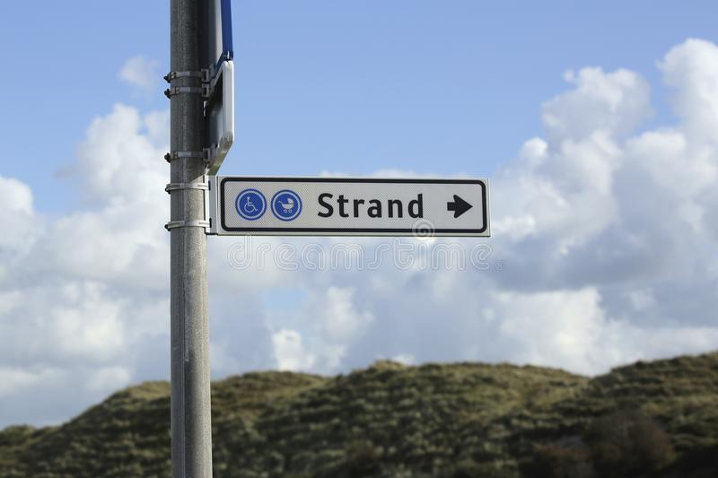 Signpost showing the way to the beach royalty free stock images