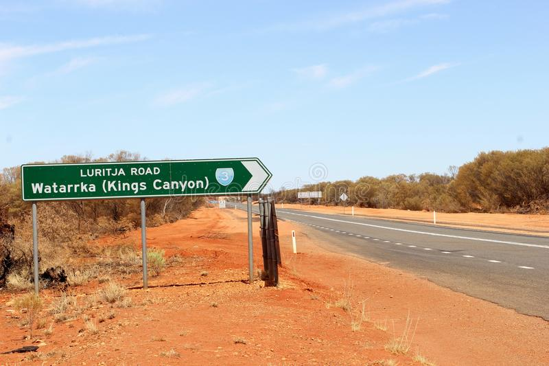 Signpost to Kings Canyon National Park (Watarrka), Australia. Signpost to Kings Canyon (Watarrka National Park) at the crossing of the Lasseter Highway and the stock image