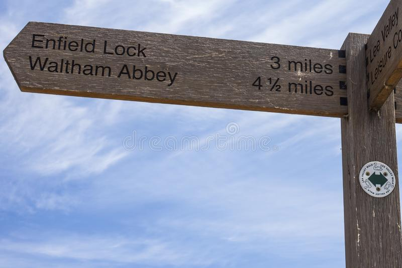 Signposts along the River Lee Navigation. Signposts on the River Lee Navigation towpath in London, showing the direction towards Enfield Lock and Waltham Abbey royalty free stock image