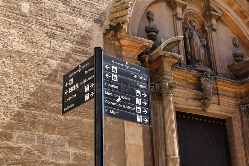 Signposts of of Palma`s landmarks with La Seu Cathedral in the background royalty free stock images
