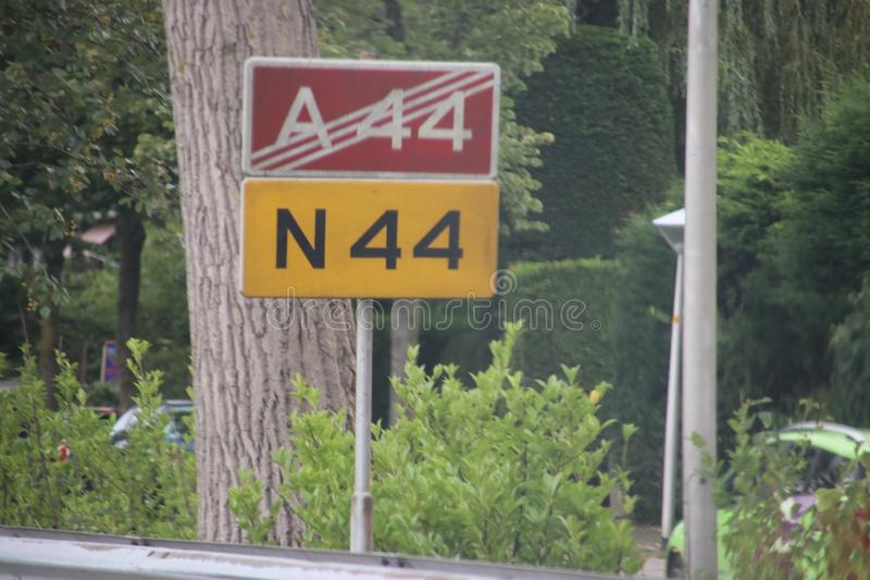 Signs along the motorway in Wassenaar that motorway A44 stops and will continue as regional road N44 in the Netherlands.  stock images