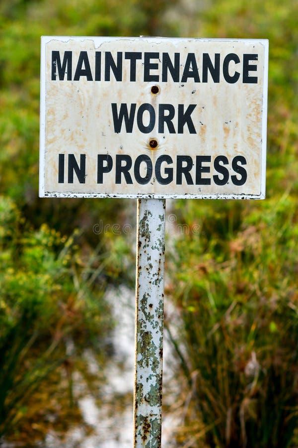 Maintenance work in progress sign board royalty free stock photo