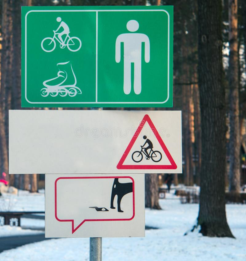 Signs for bicycle and pedestrian zone in park. royalty free stock image