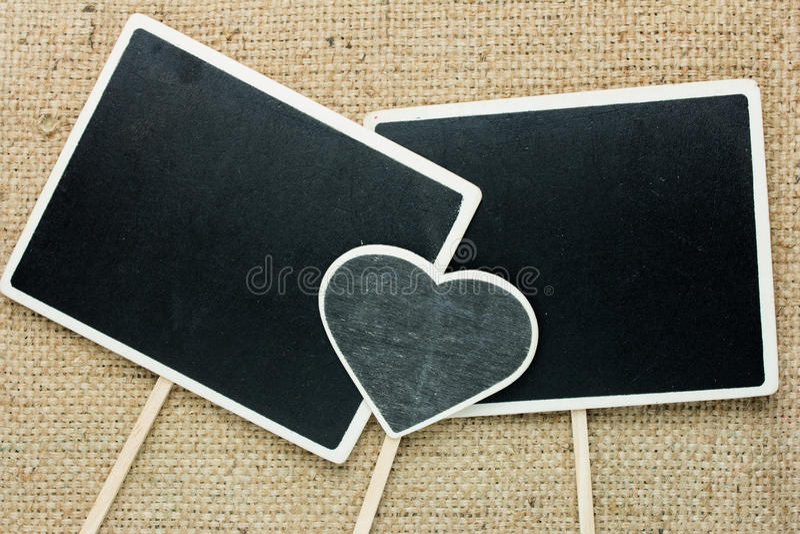 Signs blackboard rectangular and heart. stock image