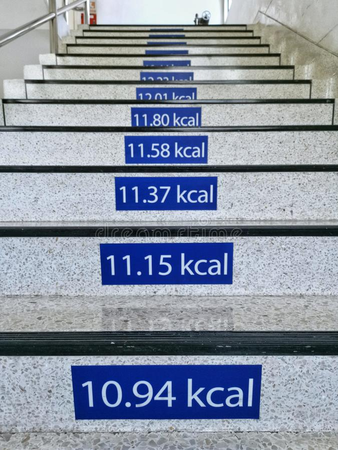 Signs of calories burn on the stairs at office royalty free stock photo