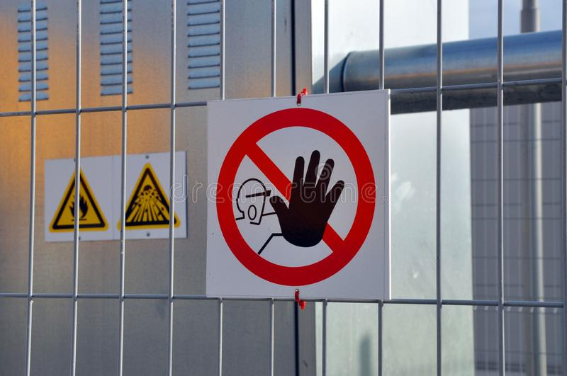 Signs do not touch authorized personnel only royalty free stock image