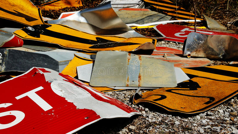 Signs everywhere. Discarded street signs piled up to be recycled royalty free stock image