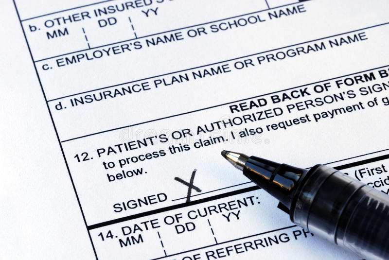 Signs the medical claim form royalty free stock photo