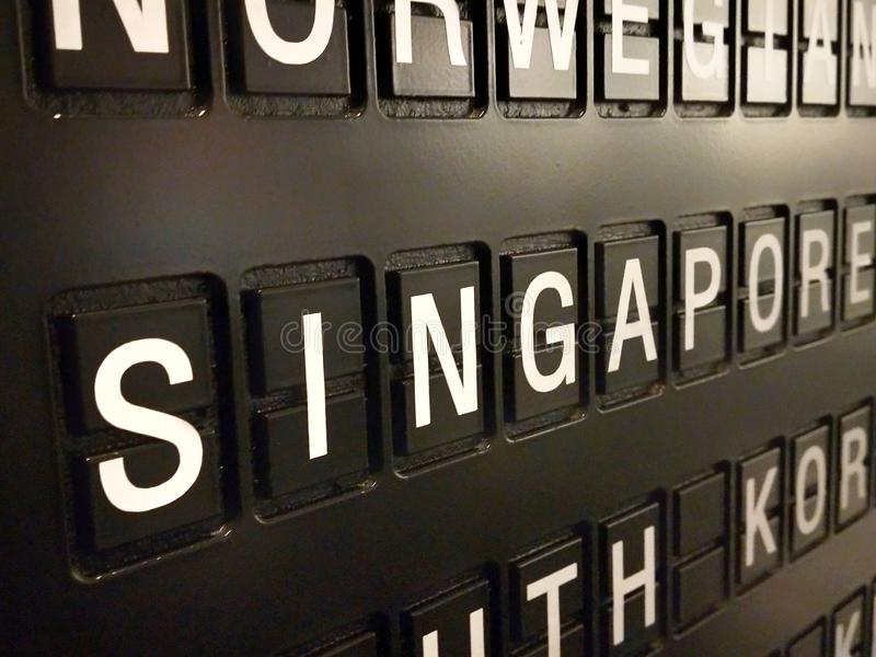 Signs name of Singapore country on black directory board. Used for For currency exchange, airport, business, finance or travel concept, Signs and symbols royalty free stock images