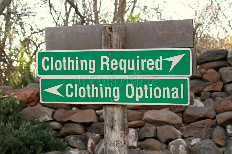 Clothing optional vs clothing required sign at beach. stock photography
