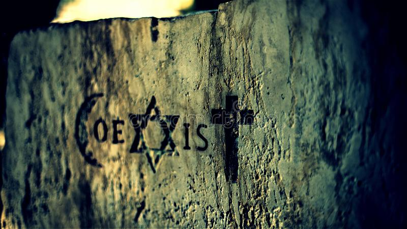 Signs and religious symbols of the Coexist movement. Religious symbols representing the 3 monotheistic religions: Muslims, Israelites and Catholics. Coexister is stock image