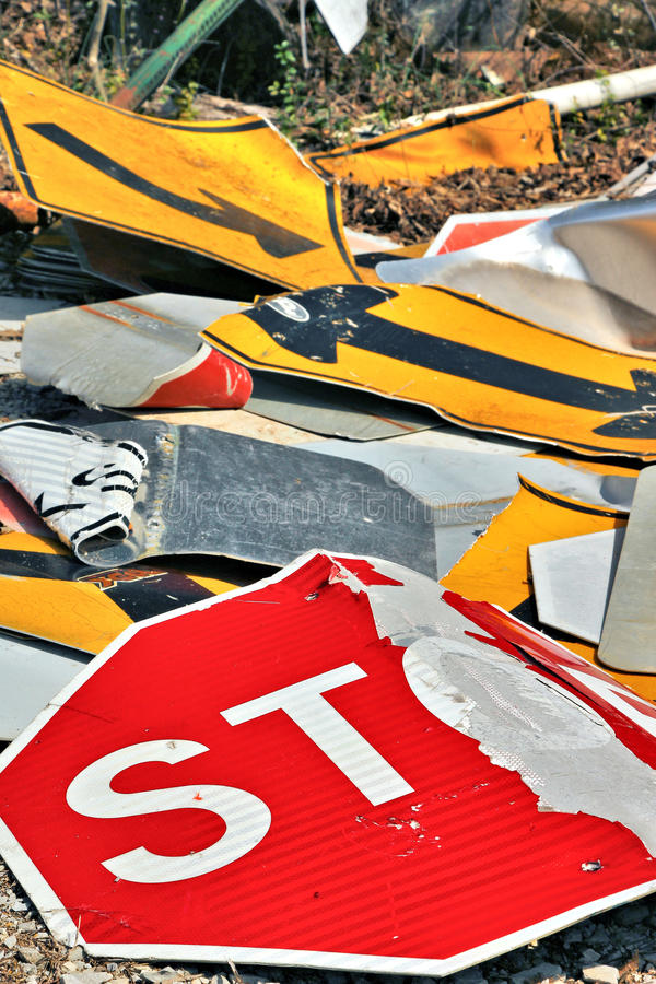 Signs signs everywhere there is signs. Discarded street signs piled up to be recycled royalty free stock photo