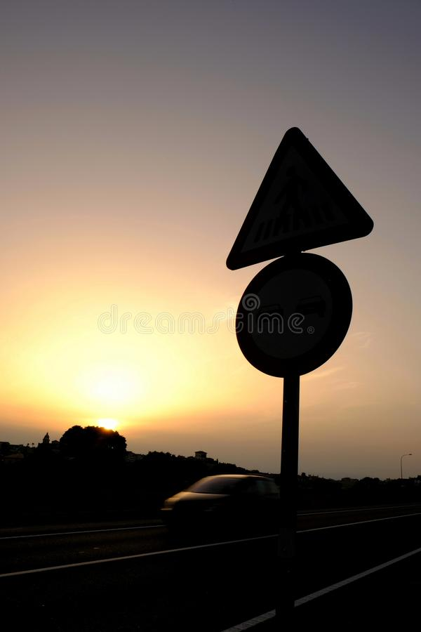 Signs of traffic at sunset. In a scundary road of Mallorca island, Spain royalty free stock image