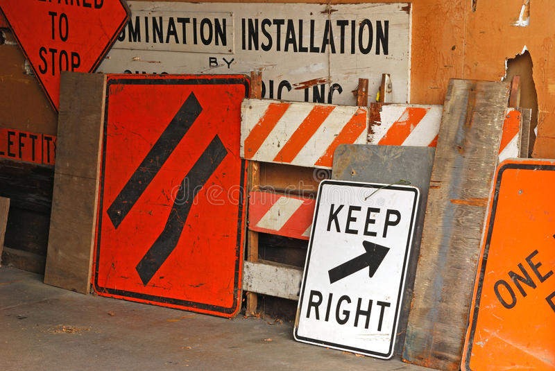 Signs on a Wall. Several traffic signs inside the shop of an Electric shop stock image
