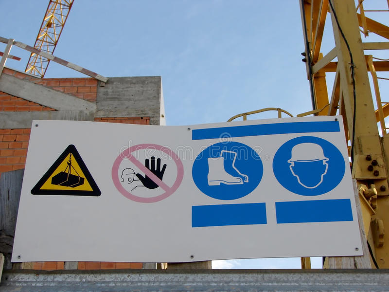 Signs of Work. Hazard warning signs at the entrance of a building site royalty free stock image