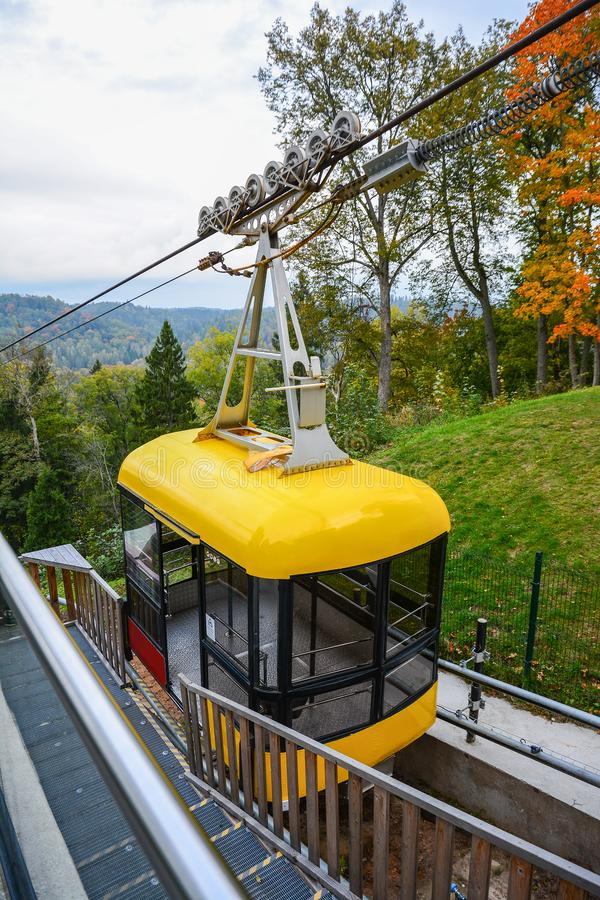 Sigulda cable car for traveling through the Gauja valley, Latvia. Panoramic view of leaf fall forest. Autumn landscape on cool,. Sigulda cable car for traveling stock image