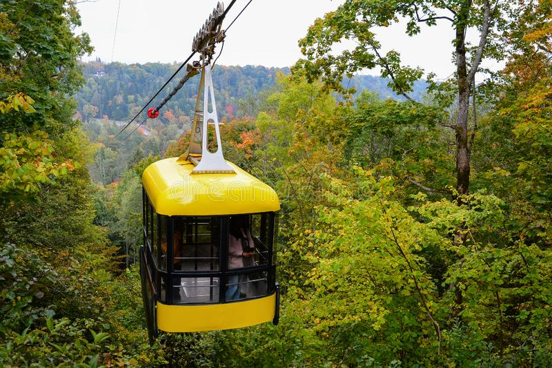 Sigulda cable car for traveling through the Gauja valley, Latvia. Panoramic view of leaf fall forest. Autumn landscape on cool,. Sigulda cable car for traveling royalty free stock image