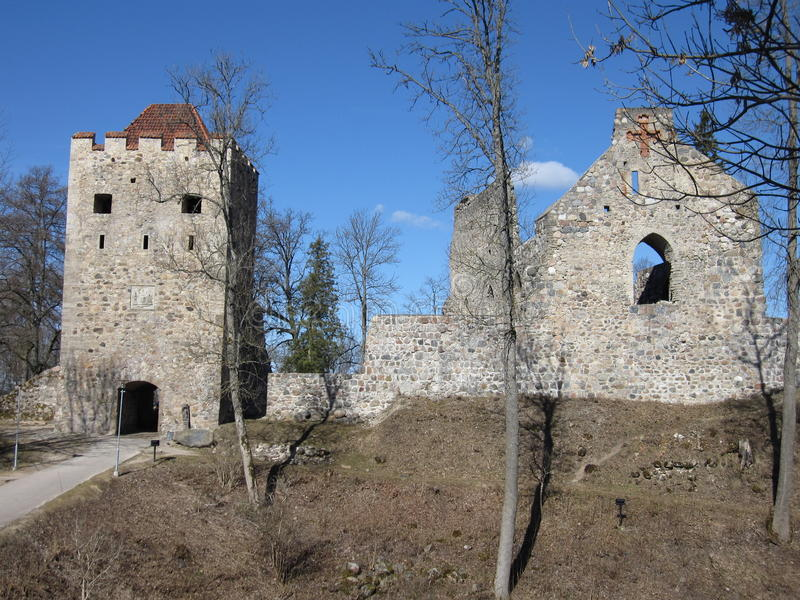 Sigulda Castle Ruin. In Gauja National Park in Latvia on a clear day with clouds and a view of the façade and towers of the Castle royalty free stock photos
