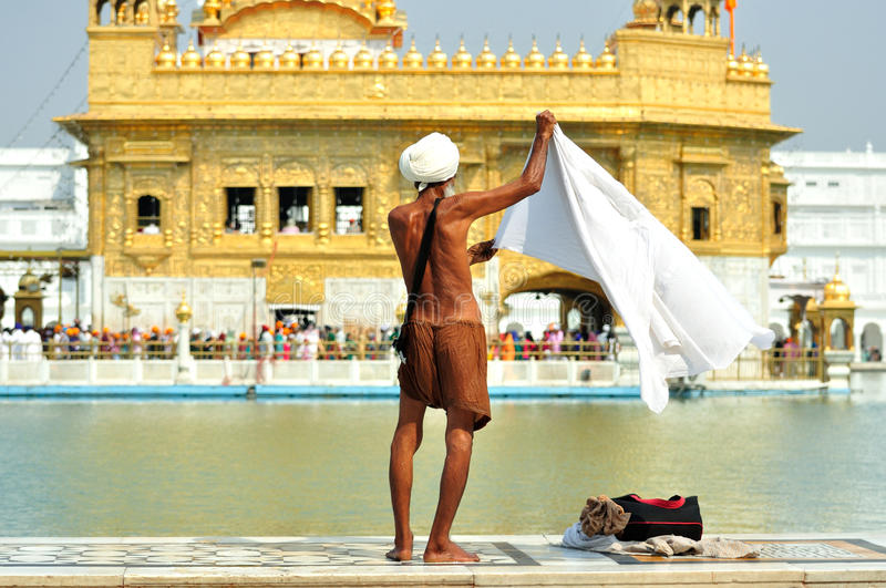 Sihk Washing Body in the Golden Temple, Amritsar royalty free stock photography