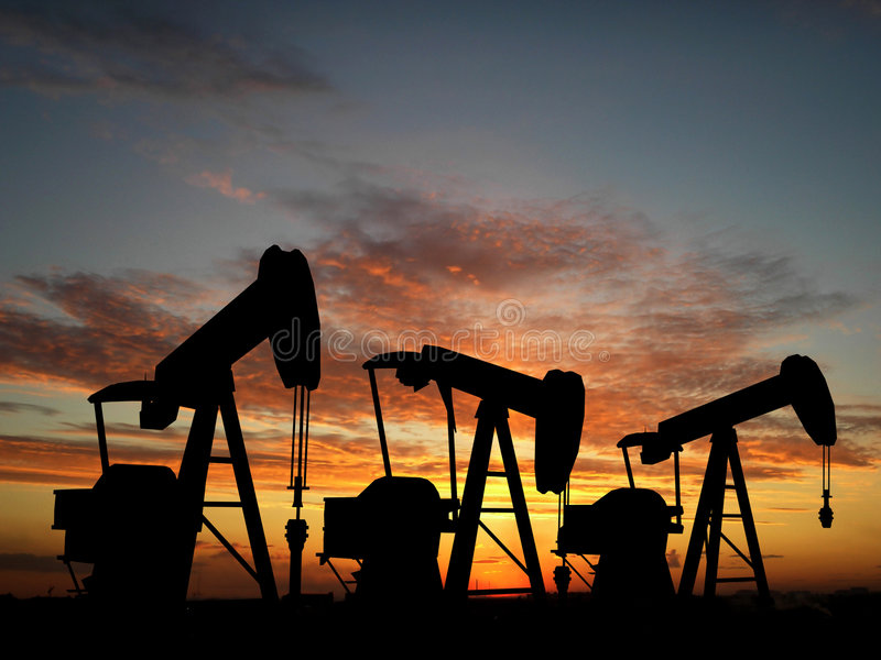 Sihouette three oil pumps royalty free stock photos