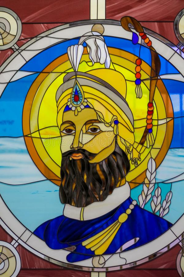 Sikh guru portrait on stained glass in the Sikh temple stock photo