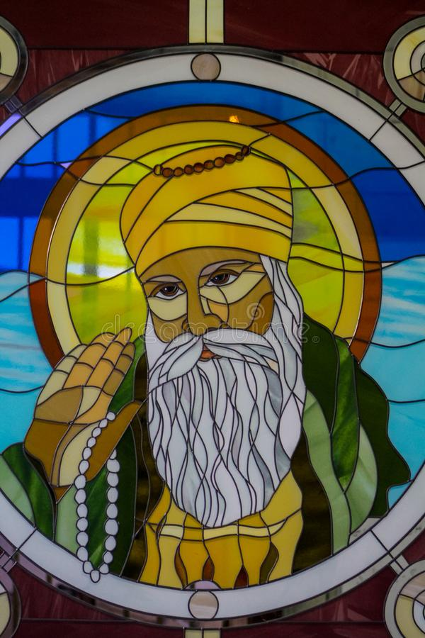 Sikh guru portrait on stained glass in the Sikh temple. Sikhism religion. Guru Nanak Dev royalty free stock images