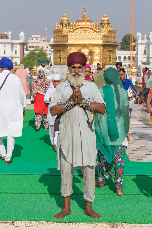 Sikh man and indian people visiting the Golden Temple in Amritsar, Punjab, India. stock image