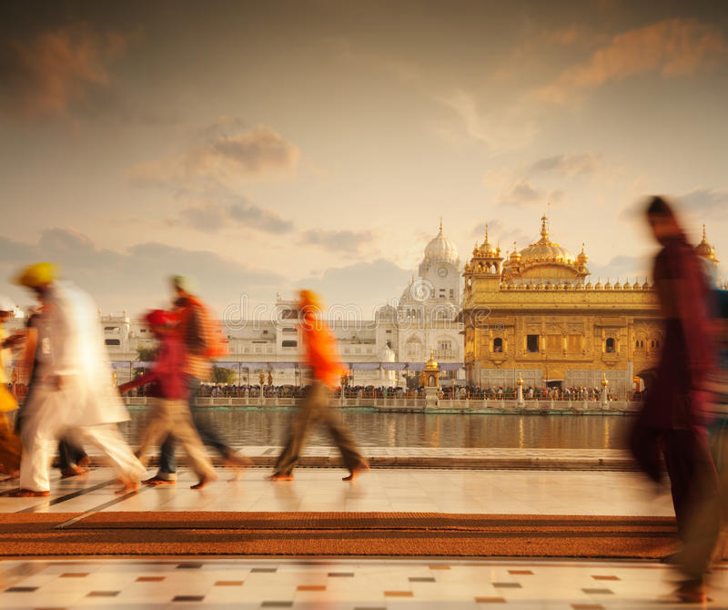 Sikh pilgrims in Golden Temple India. Group of Sikh pilgrims walking by the holy pool, Golden Temple, Amritsar, Pun jab state, India, Asia stock photography