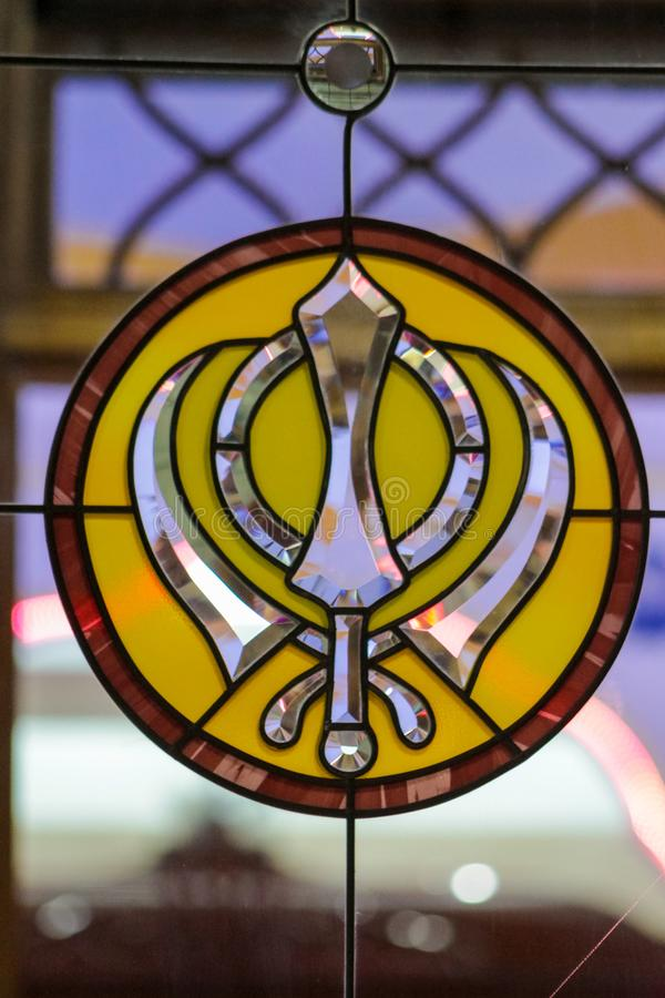 Sikh symbol on stained glass in the Sikh temple. Sikh religious symbol on stained glass in the Sikh temple. Sikhism religion. Guru Gobind Singh stock image
